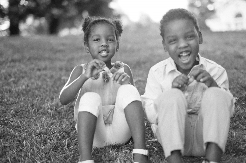 film photo of two kids laughing by Samantha Kirk