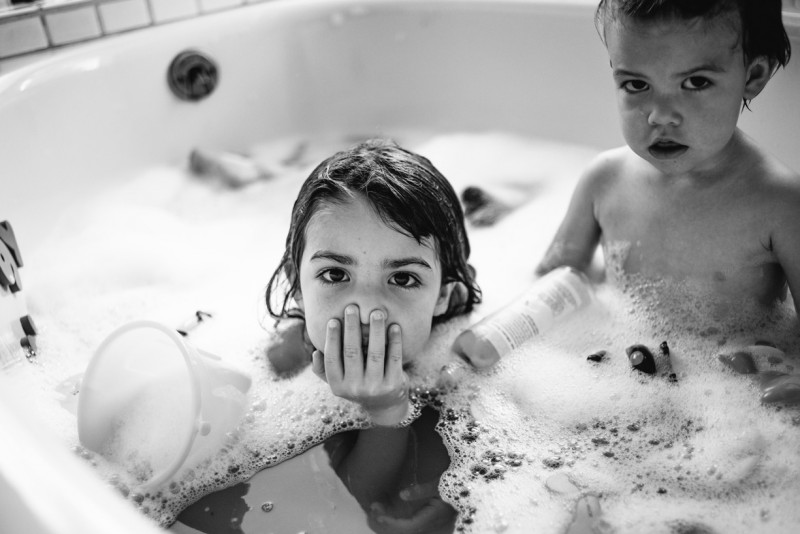 kids playing in bubble bath by Pamela Bernasconi