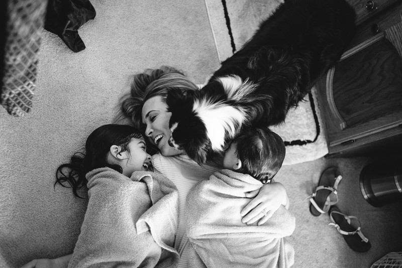 black and white photo of mom and two daughters with dog by Pamela Bernasconi