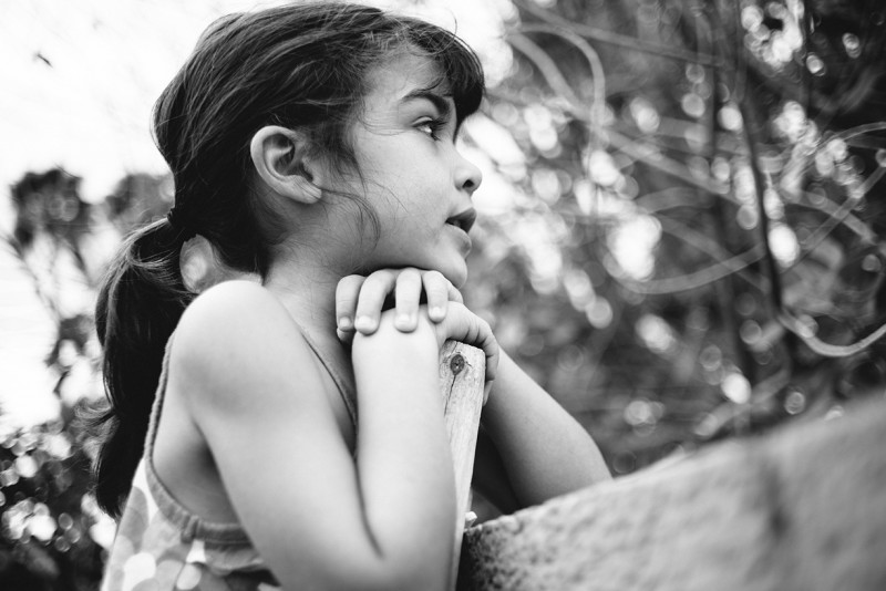 black and white photo of young girl by Pamela Bernasconi