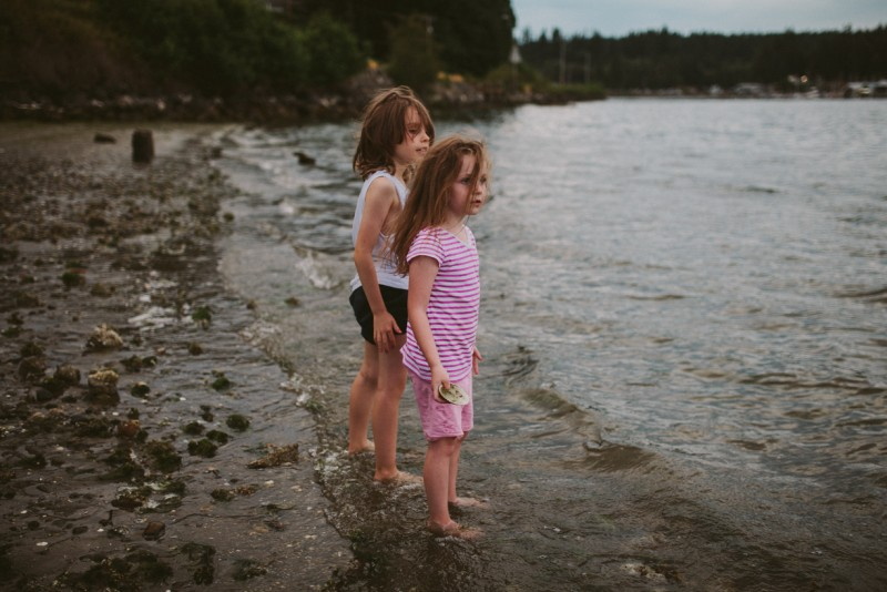 boy and girl looking out into the water by Meghann Prouse