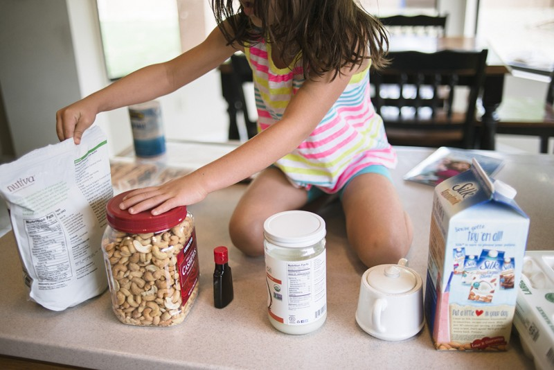 girl getting food on the kitchen counter by Pamela Bernasconi