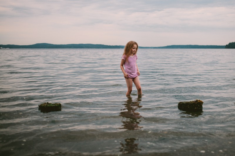 girl standing in the water by Meghann Prouse