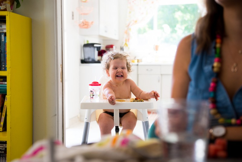 toddler sitting in highchair by Nicole Cross