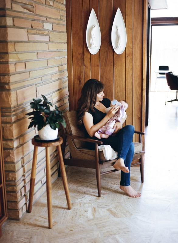 film photo of mom sitting in chair feeding baby by Angie Mertz