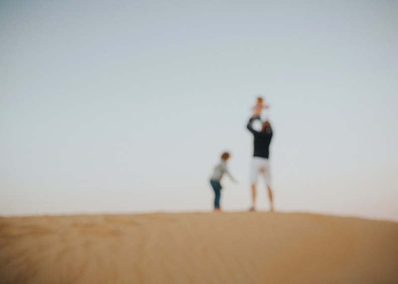 photo of a family exploring the Dubai desert by Nina Tantzen