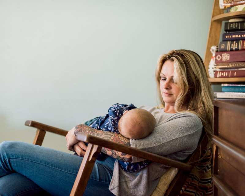 picture of mom holding baby by Bernadette Madden