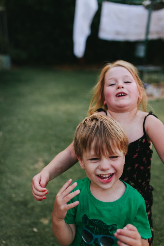 pictures of a family playing football in their backyard by Krystle Ricci