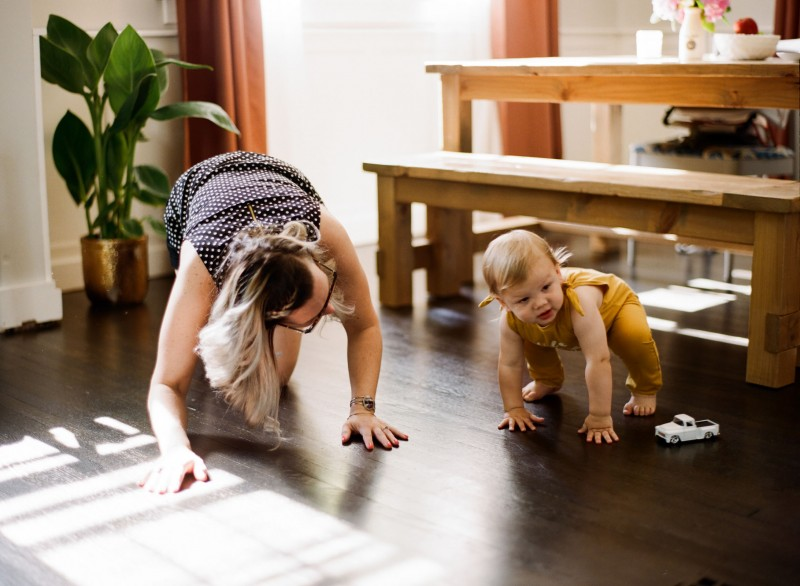 mom and daughter playing on the floor by Paige Gabert