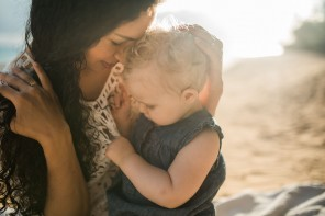 photo of mom and daughter on the Hawaii beach by Cadence Feeley