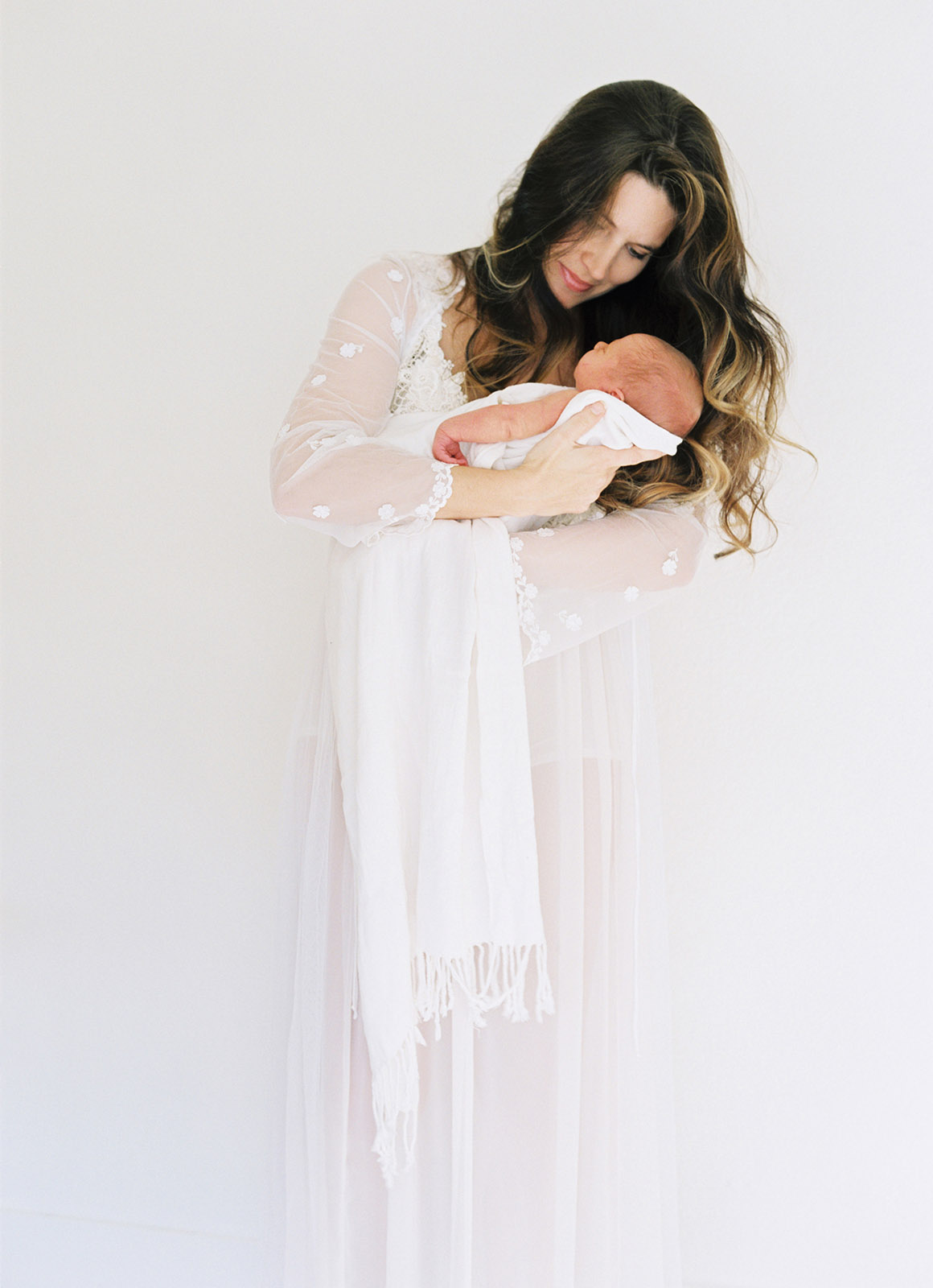 natural light photo of mom holding baby by Lexia Frank