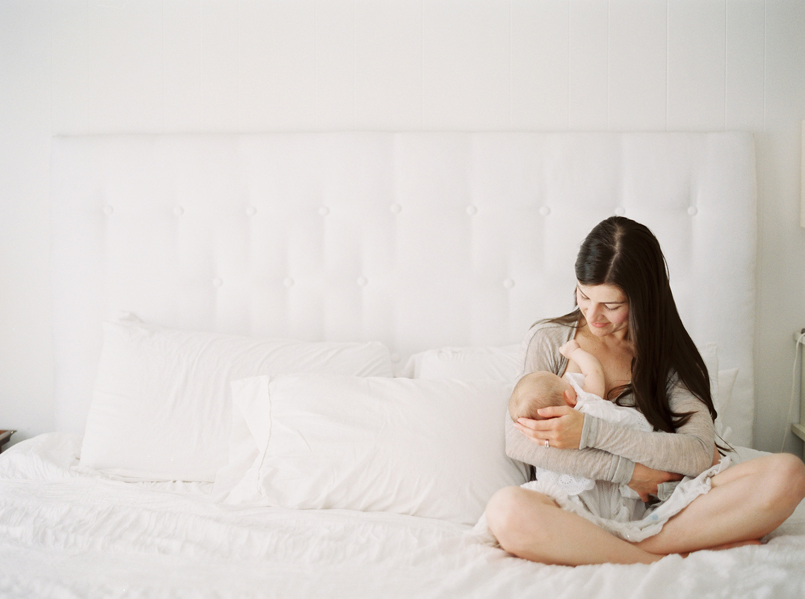 photo of mom breastfeeding newborn by film photographer Lexia Frank