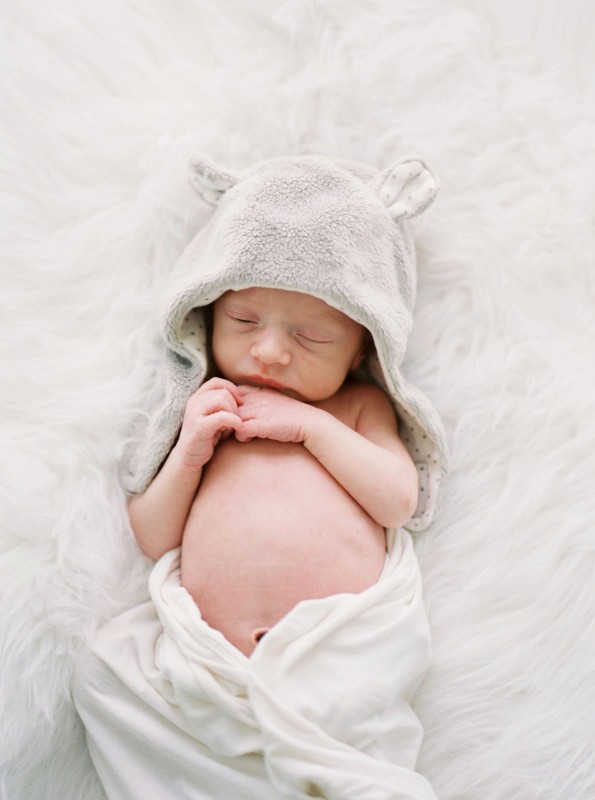 picture of newborn in an animal hat by Leanne Vice