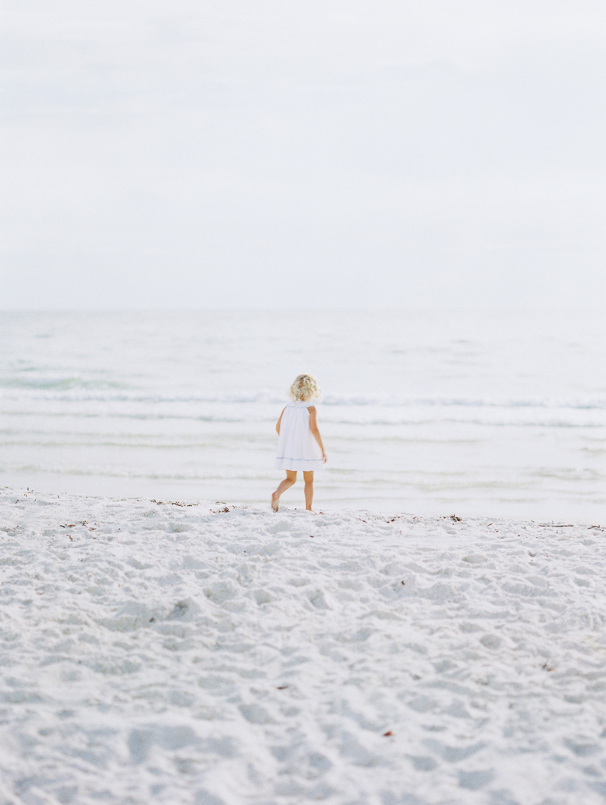 film photo session of mom and toddler at Clearwater Beach by Justine Wright