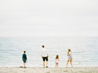 family photo session on a beach by Vicky Lamburn